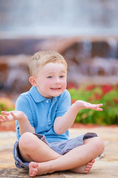 little boy makes funny faces during photo session