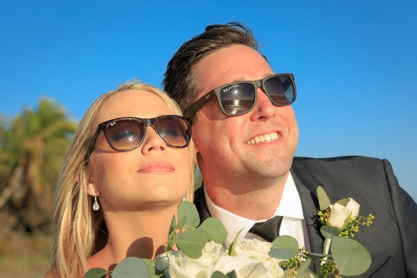 wedding couple enjoy sun after ceremony