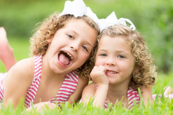 sisters play during photo session