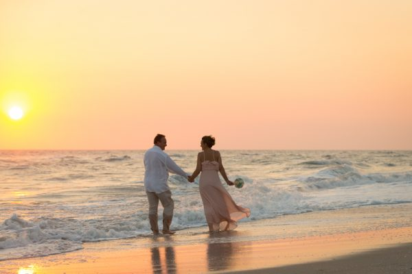 Great sunset for couple at Sanibel Island beach