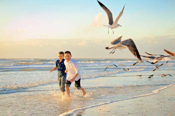 children run on Marco Island beach