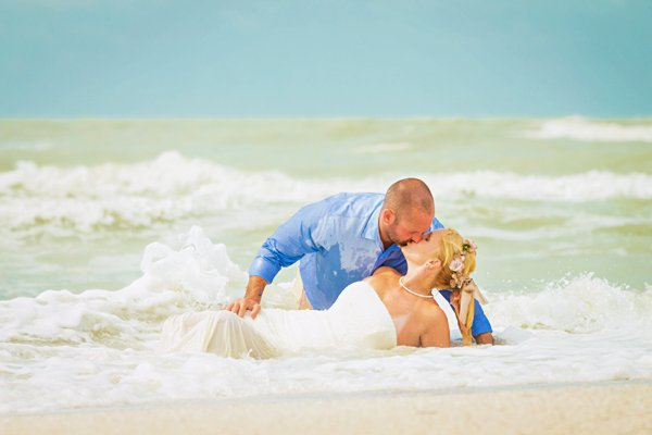 newlyweds enjoy beach