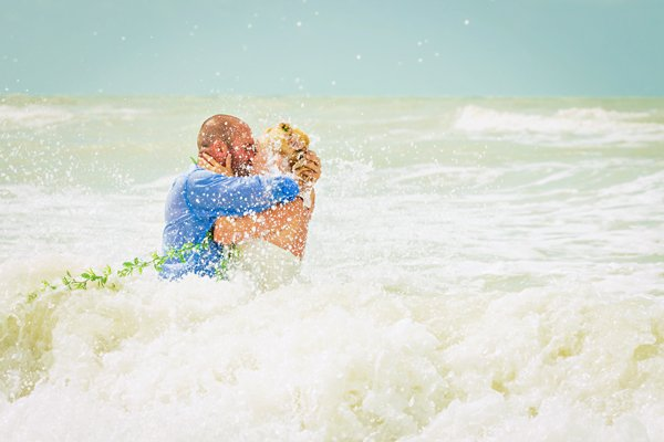 newlyweds enjoy beach photo