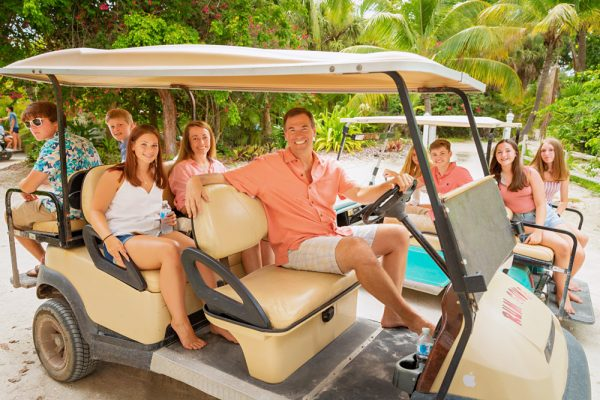 family in golf carts