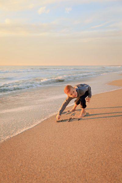 boy writes name in sand on Captiva Island