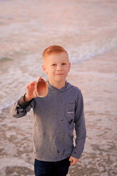 boy finds shell on Captiva Island vacation