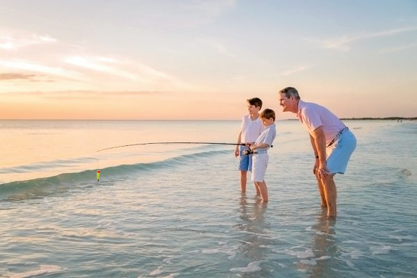 photo of dad and sons fishing
